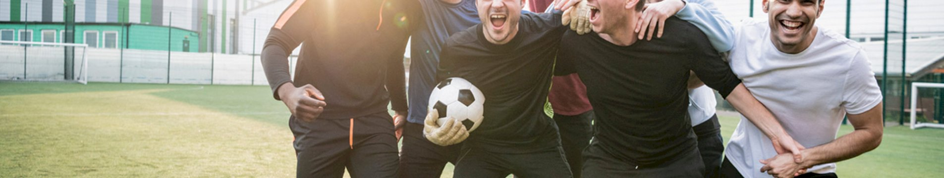Group of men posing with football