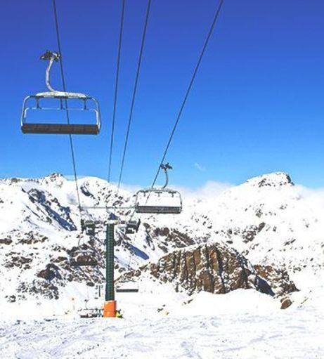 Sunny day looking over snow covered mountains. Explore Andorra Stag Party ideas below: