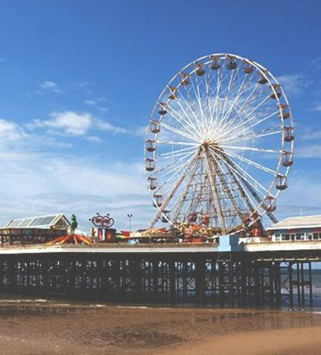 View of the Blackpool pier and ferris wheel. Discover Blackpool Stag Party ideas below: