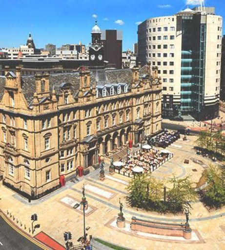 Sunny view of Leeds' City Square. Explore Leeds Stag Party ideas below: