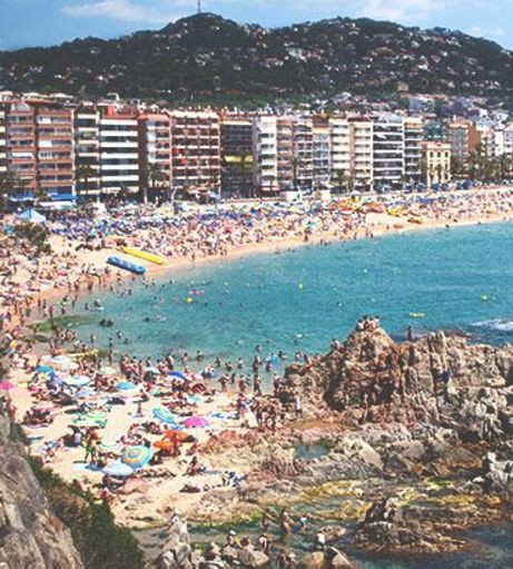 Looking over the crowds at Lloret de Mar beach. Discover Lloret de Mar Stag Party ideas be