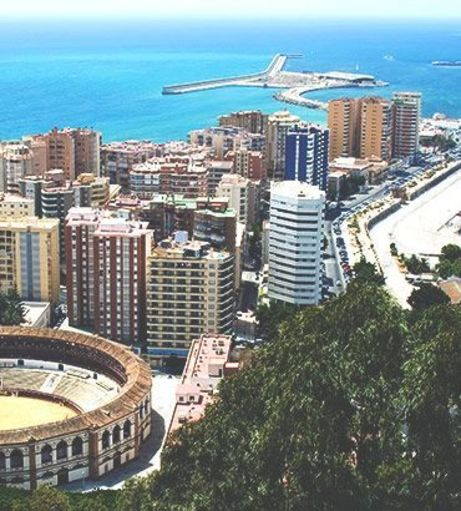 Aerial view over the coast, Plaza de Toros de la Malagueta and Paseo del Parque. Discover