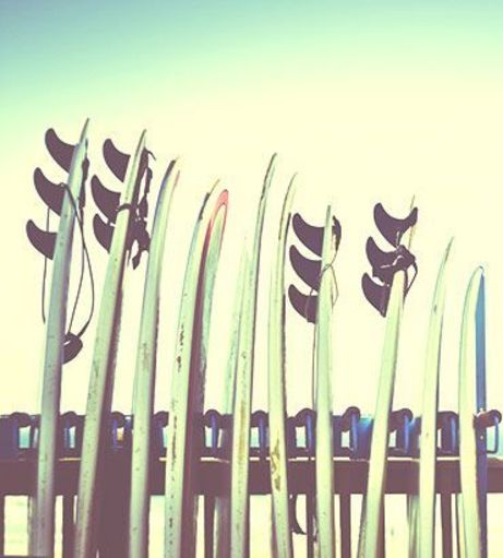 Surfboards in a rack. Discover Newquay Stag Party ideas below: