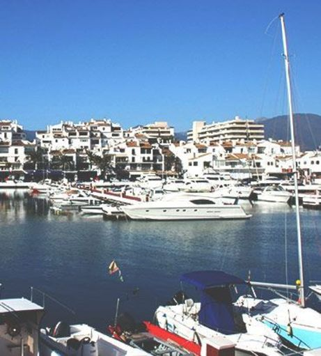 View of superyachts moored in the Puerto Banus Marina Complex. Explore Puerto Banus Stag P