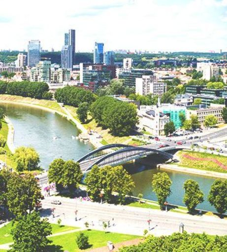 Cityscape featuring the Neris River and the Mindaugas Bridge. Discover Vilnius Stag Party