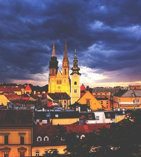 View of the Zagreb Cathedral under a stormy night sky. Discover Zagreb Stag Party ideas be